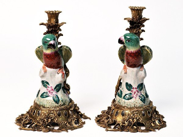 16: A PAIR OF TROPICAL BIRD PORCELAIN AND BRASS CANDLES