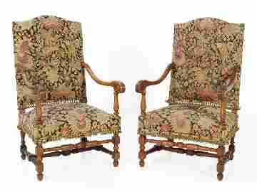 51: A PAIR OF LOUIS XV WALNUT ARMCHAIRS France Nineteen