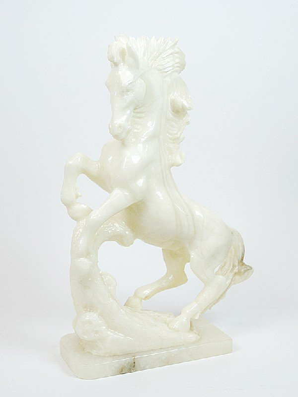3: A CARVED MARBLE STALLION ON BASE