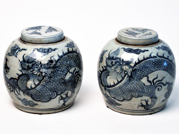 13: A PAIR OF BLUE AND WHITE COVERED JARS