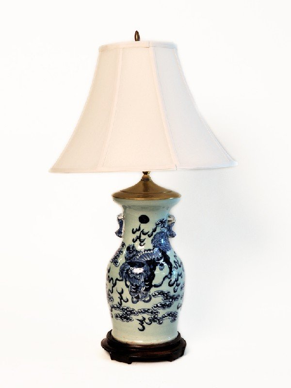 20: AN ANTIQUE ASIAN VASE CONVERTED INTO A LAMP