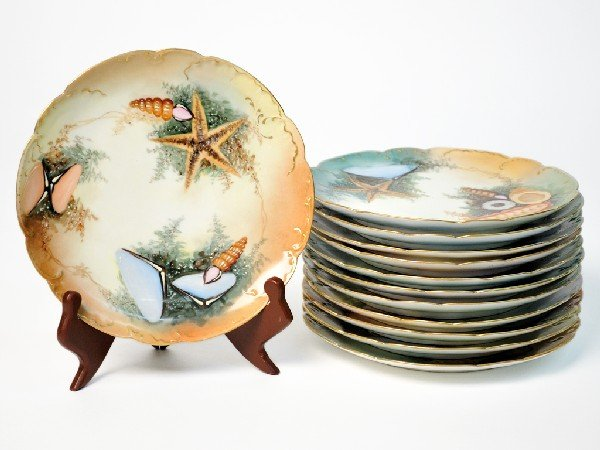 6: A COLLECTION OF TWELVE HAND PAINTED HAVILAND PLATES