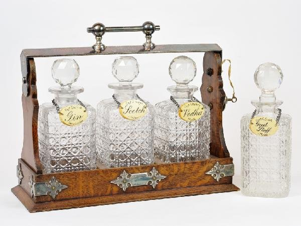 9: A SET OF THREE CUT CRYSTAL DECANTERS IN A DECORATIVE