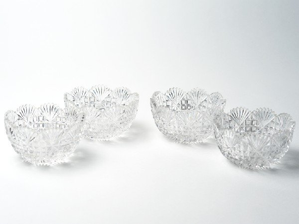 12: A GROUP OF FOUR CRYSTAL CUT BOWLS