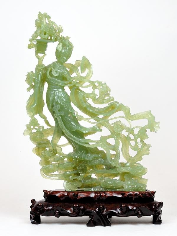 18: A CARVED JADEITE FEMALE FIGURE ON A ROSEWOOD BASE