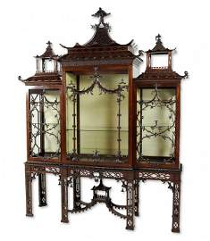 28: A CHIPPENDALE STYLE CABINET-ON-STAND England, Late