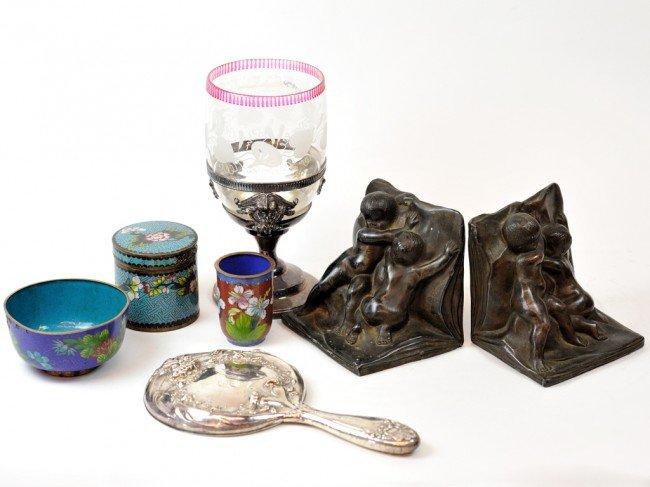 11: A VICTORIAN GLASS GOBLET, CAST METAL BOOKENDS, A GR