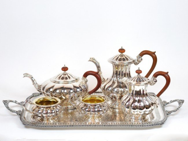 23: A SILVER PLATED TEA SET WITH AN EMBOSSED AND ENGRAV