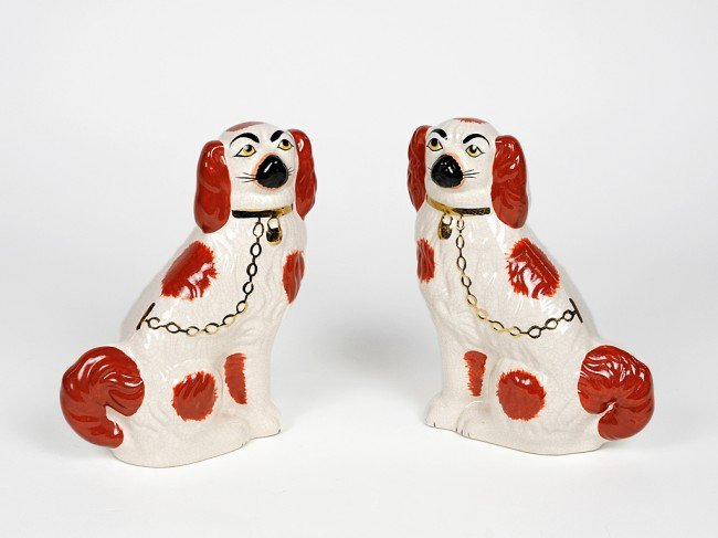 12: A PAIR OF GLAZED STAFFORDSHIRE PEKINGESE DOGS