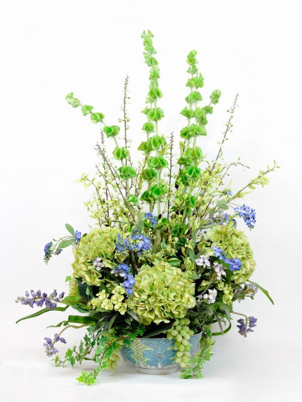 18: A SILK FLORAL ARRANGEMENT FILLED WITH HYDRANGEAS, P