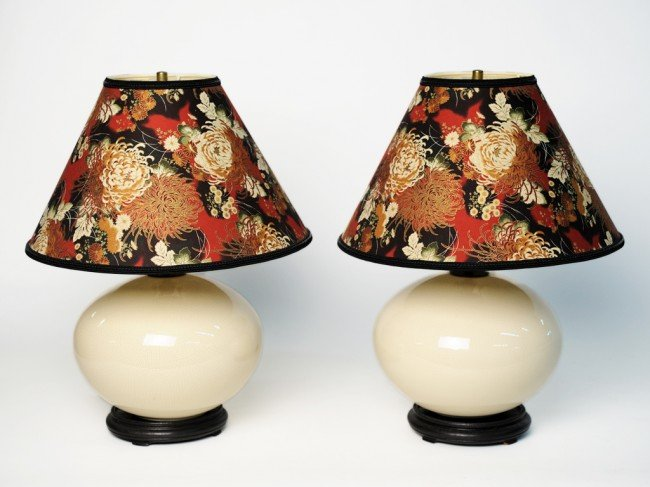 7: A PAIR OF BULBOUS CERAMIC LAMPS WITH FLORAL SHADES