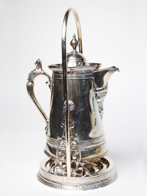 13: A SILVER PLATE LEMONADE PITCHER ON ROTATING STAND