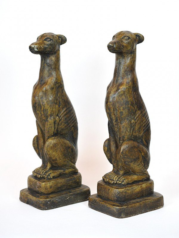 18: A PAIR OF PAINTED CONCRETE STATUES DEPICTING SITTIN