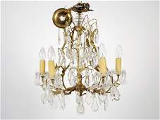 77 A BRONZE AND CRYSTAL FIVE LIGHT CHANDELIER French