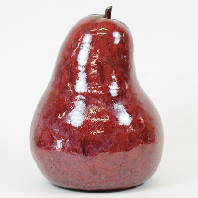 7: A LARGE RED CERAMIC PEAR