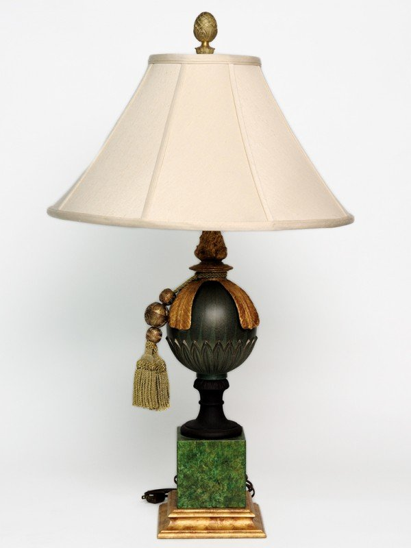 19: A GREEN PAINTED BRONZE GLOBE TABLE LAMP WITH GILDED