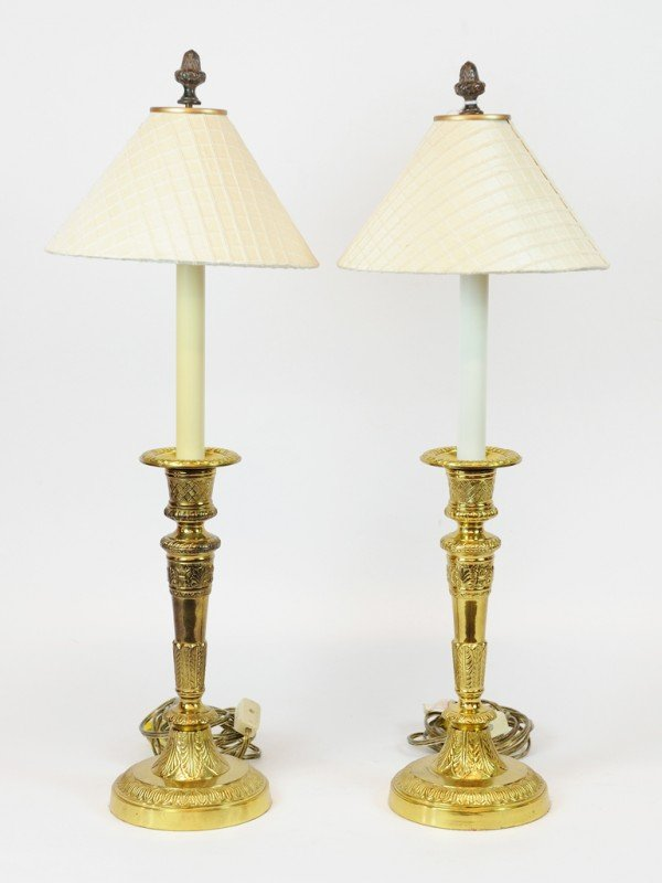 22: A PAIR OF SINGLE LIGHT BRASS LAMPS WITH SHADES