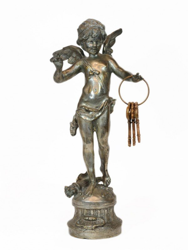 10: A STANDING BRONZE CUPID ON BASE