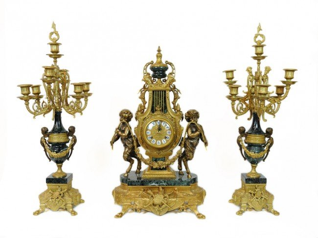 44: AN IMPERIAL ITALIAN EMPIRE STYLE MANTLE CLOCK SET O