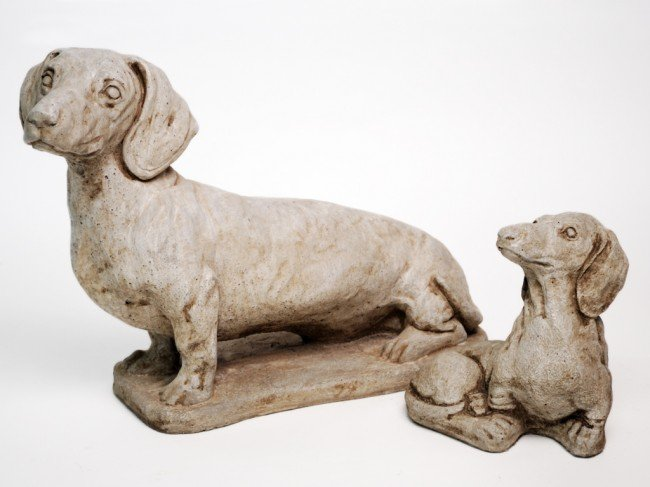 4: A PAIR OF CONCRETE DACHSHUNDS