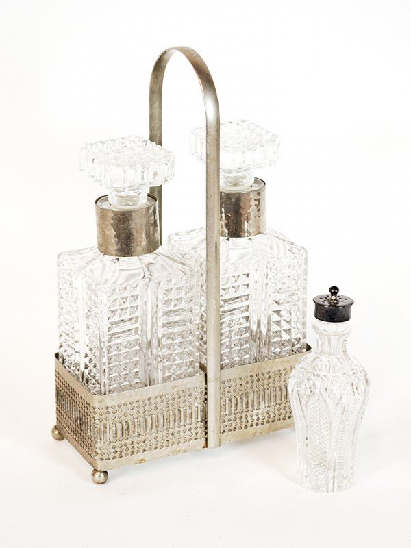 13: A MODERN CAST GLASS DECANTER SET TOGETHER WITH ANTI