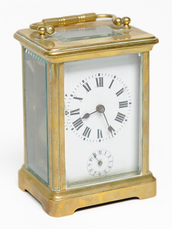 23: A FRENCH BRONZE CARRIAGE CLOCK, France
