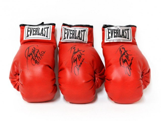 1A: A TRIO OF LARRY HOLMES SIGNED EVERLAST BOXING GLOVE