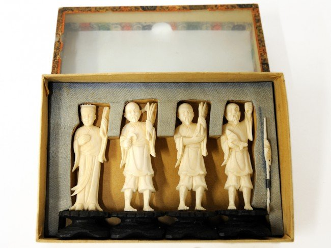 9: A SET OF FOUR IVORY CARVED OKIMONOS ON STANDS China