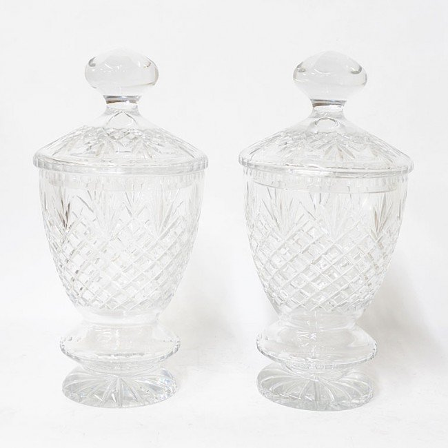 19: A PAIR OF CUT CRYSTAL LIDDED URNS