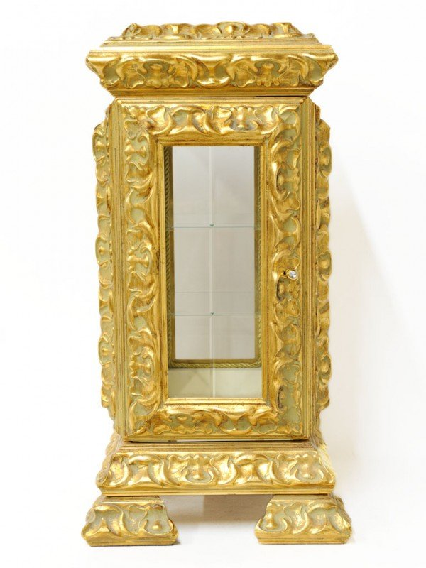 23: A RELIEF CARVED GILTWOOD DISPLAY CASE