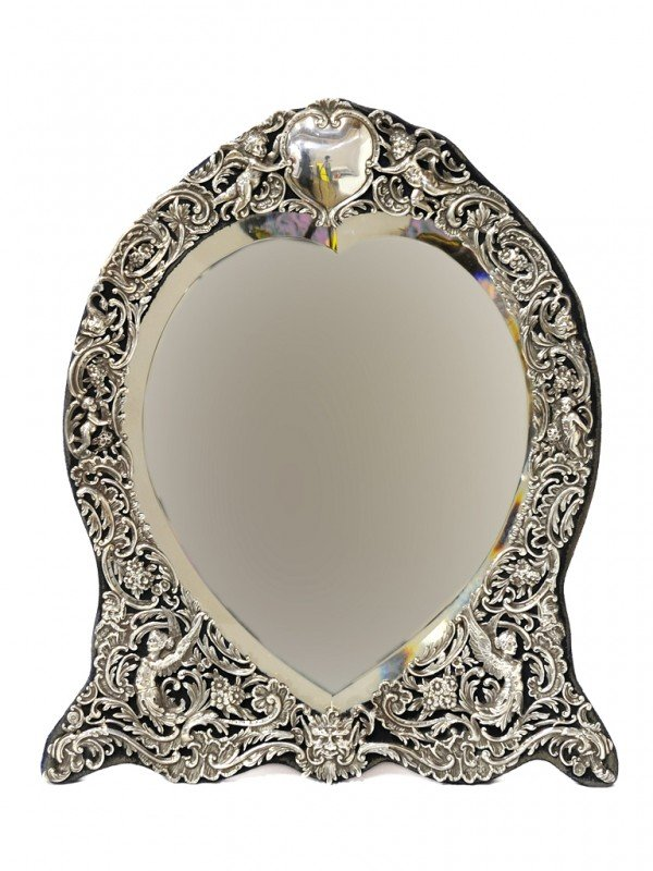 6: A FINE ENGLISH STERLING HEART-SHAPED DRESSING MIRROR