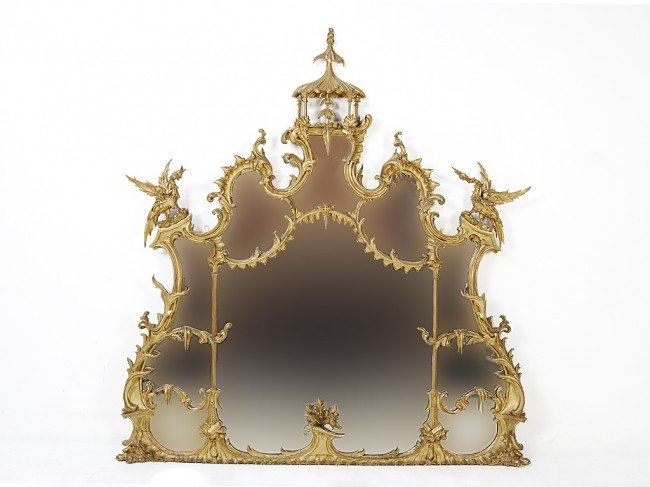 67: A RARE CHINESE CHIPPENDALE CARVED GILTWOOD MIRROR