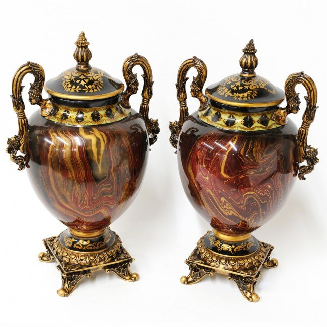 13: A PAIR OF MARBLEIZED COMPOSITION COVERED URNS