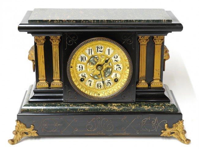 16: A SETH THOMAS MANTEL CLOCK WITH MARBLEIZED WOOD