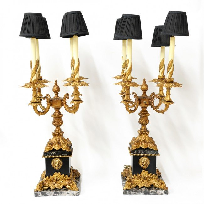 17: A PAIR OF MARBLE AND BRONZE FOUR LIGHT LAMPS