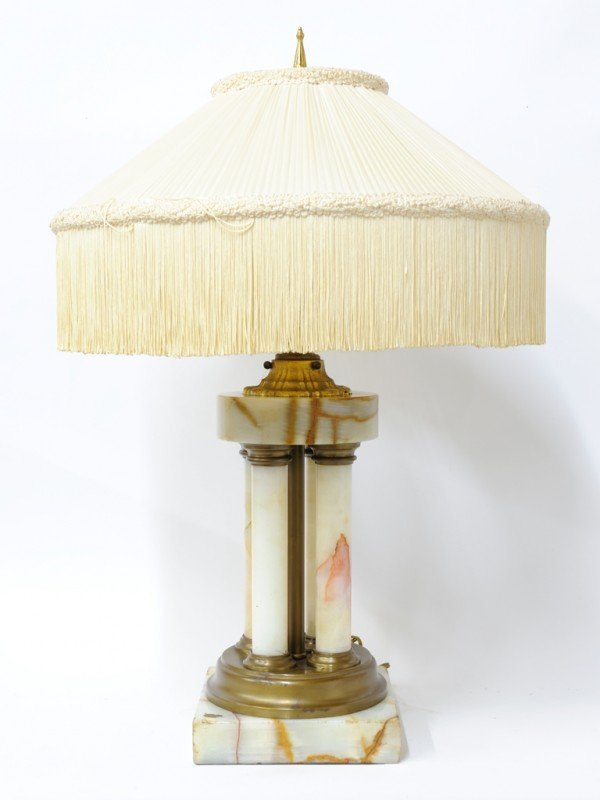 23: A FOUR COLUMN ALABASTER AND BRONZE TABLE LAMP