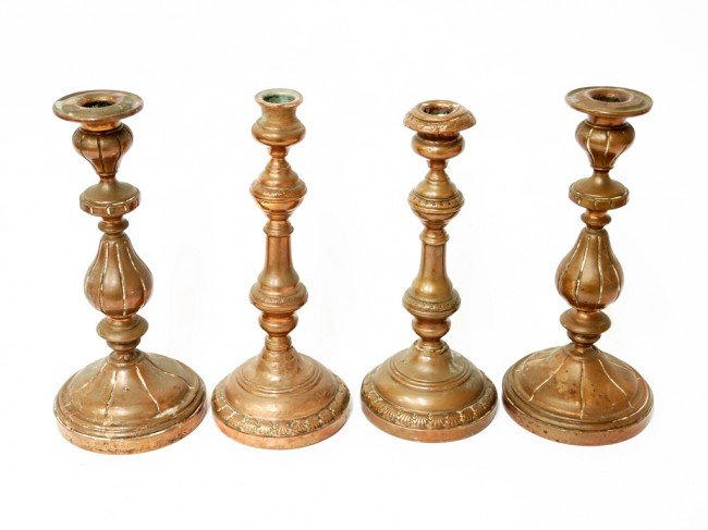 6: A GROUP OF FOUR ITALIAN COPPER CANDLE STICKS