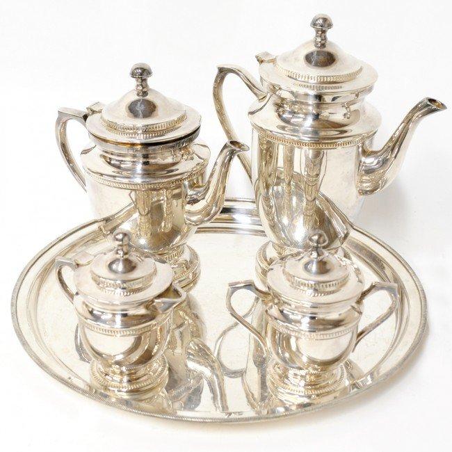 16: A GEORGIAN STYLE SILVERPLATE FIVE PIECE TEA SET