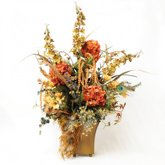 1: A SILK FLORAL ARRANGEMENT WITH FEATHERS