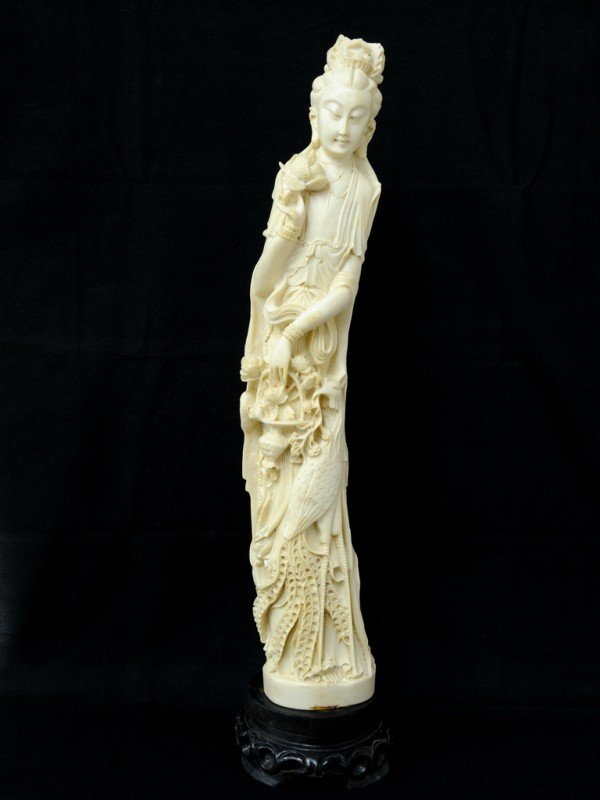 20: AN ASIAN COMPOSITION SCULPTURE OF A BUDDHIST GODDES