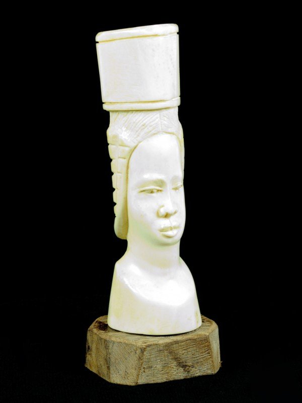 17: A HOLLOW CARVED IVORY AFRICAN WOMAN