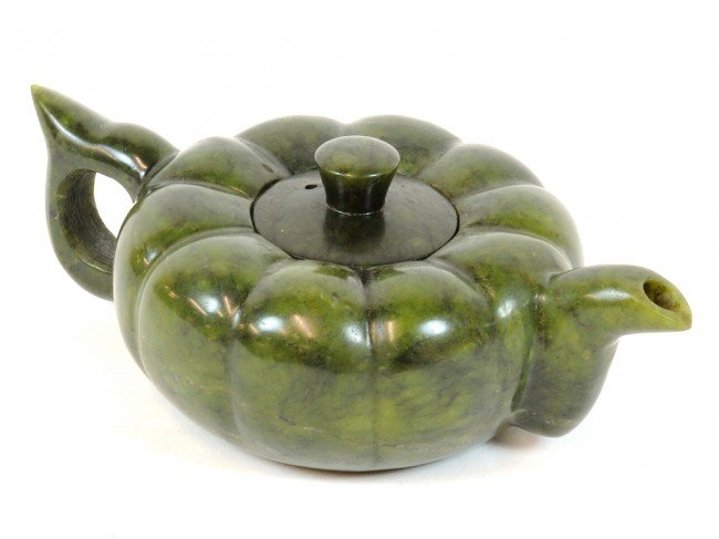 21: A CHINESE FINELY CARVED SPINACH GREEN JADE TEAPOT,