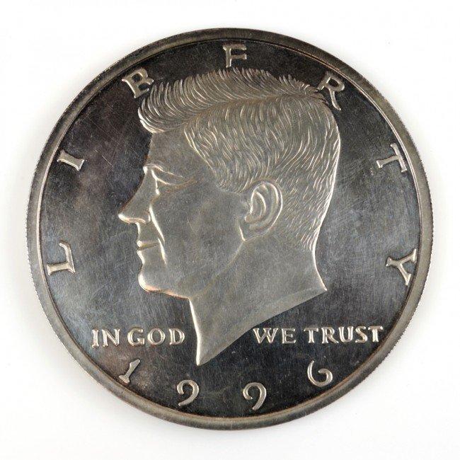 13: ONE HALF TROY POUND .999 SILVER COIN REPLICA