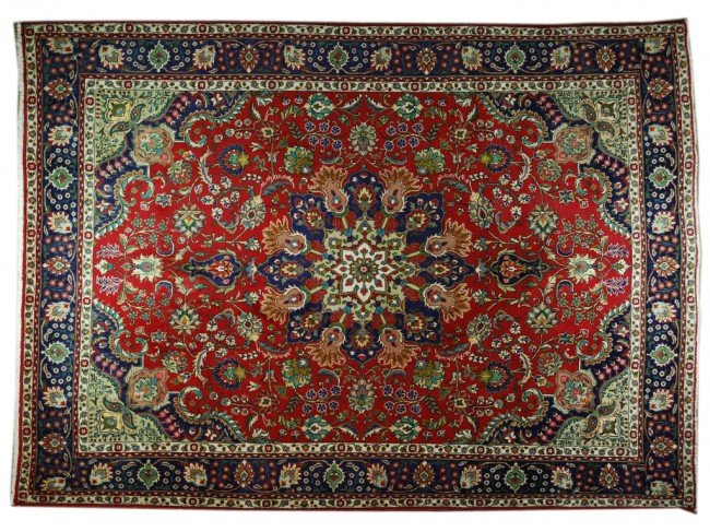 124: A PERSIAN TABRIZ RUG 9 ft 10 in x 13 ft 3 in