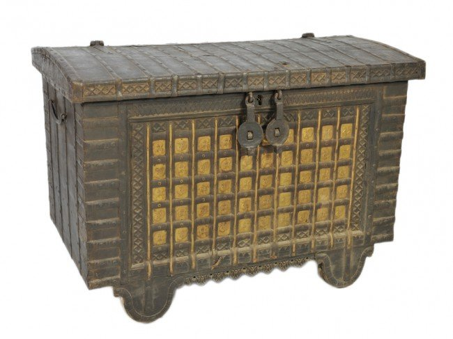 223: AN ANTIQUE IRON TRUNK WITH GILT BRASS EMBOSSED PAN