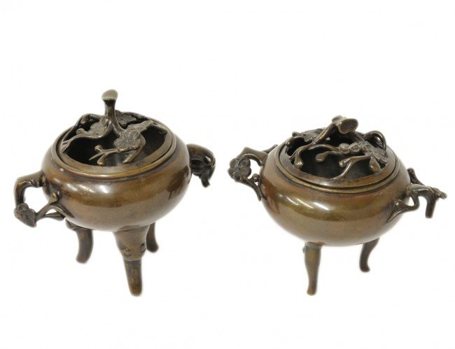 7: A PAIR OF BRONZE ASIAN CENSERS with cherry blossom m