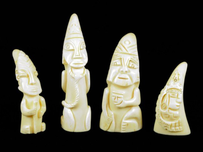 11: A LOT OF FOUR SMALL CARVED IVORY TUSKS, African