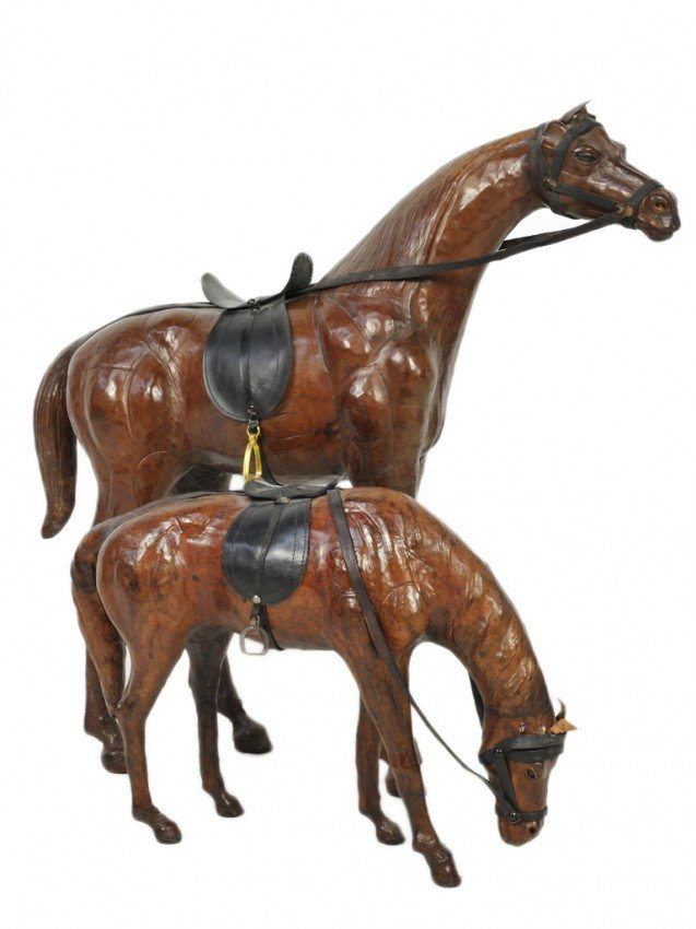 41: A PAIR OF MOLDED AND FORMED LEATHER HORSES
