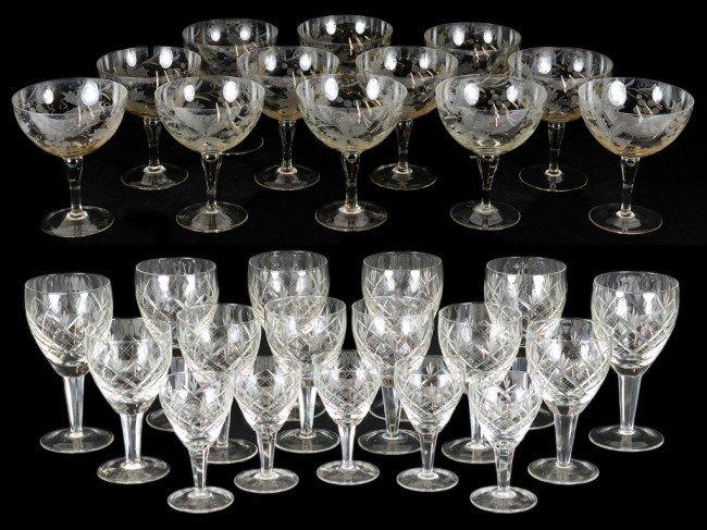 1: A SET OF CUT GLASS STEMWARE; A SET OF TWELVE ETCHED