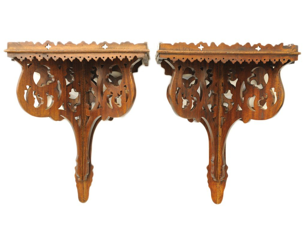 22: A PAIR OF PIERCED CARVED WALL BRACKETS